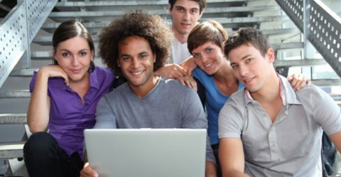 Group of college students with laptop computer.